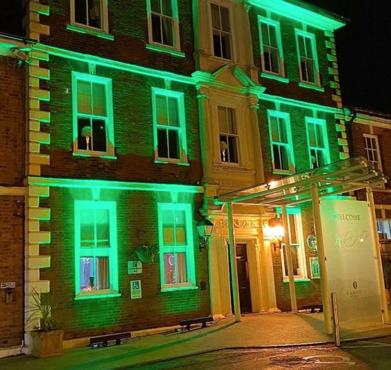 Buildings lit up green to banish the blues