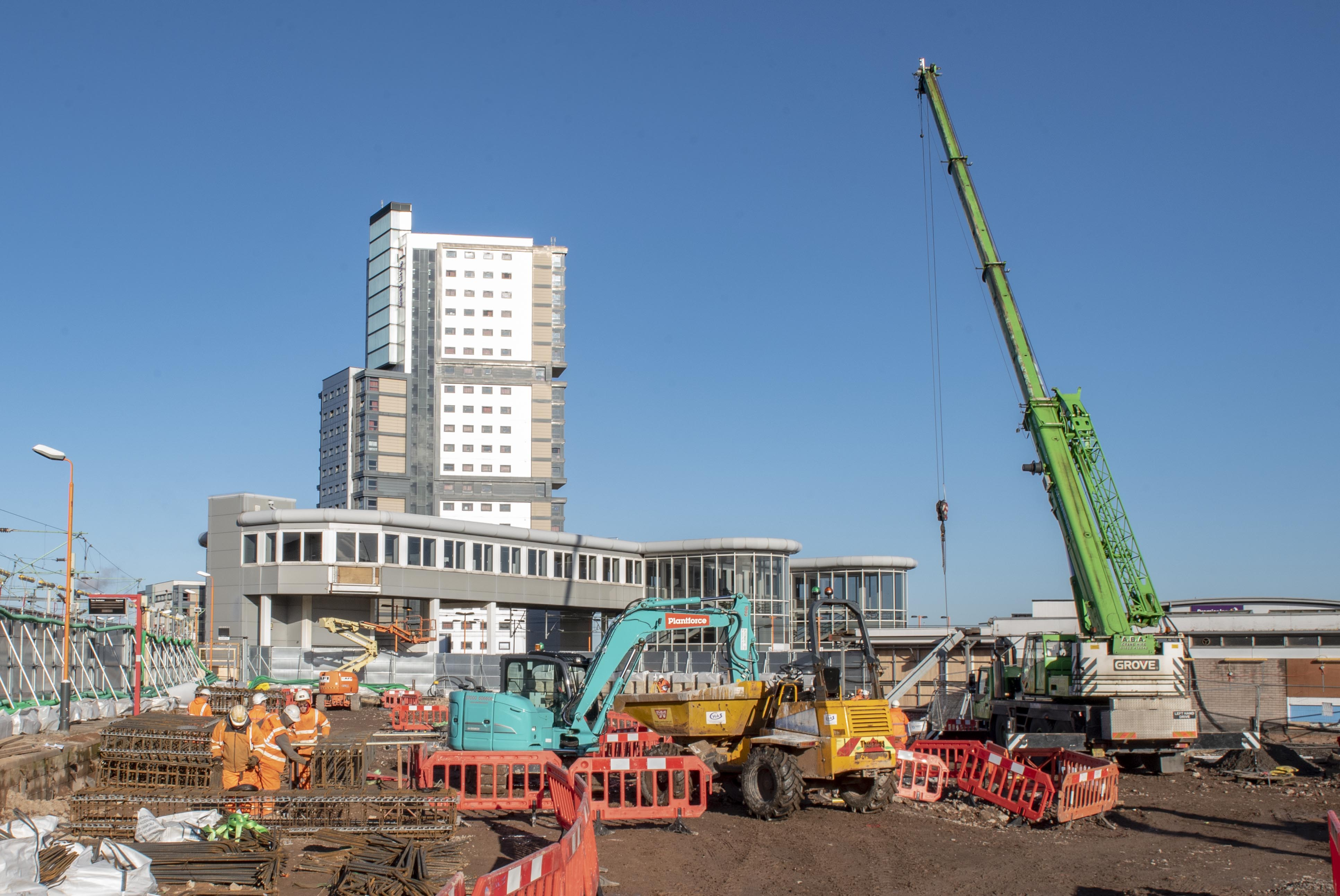 Railway station build to step up as crane arrives